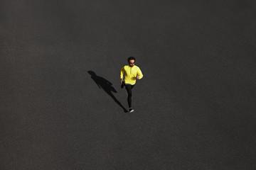 Top view runner man running sprinting for success on run