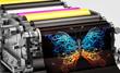 Leinwanddruck Bild - printing machine showing an abstract butterfly print