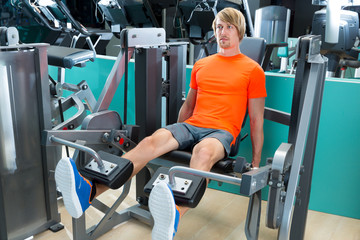 Gym man leg extension cuadriceps exercise