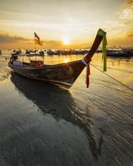 Traditional thai boats at sunset beach. Ao Nang, Krabi province