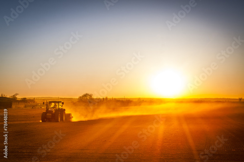 Farmer preparing his field in a tractor ready for spring - 78448039