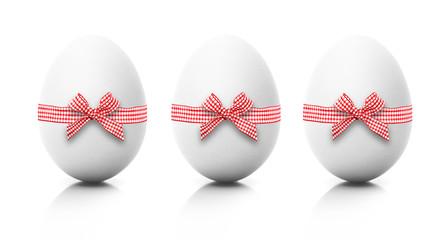 Drei Eier mit Roter Schleife