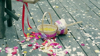 Wedding decoration, colorful petals of roses, baskets.