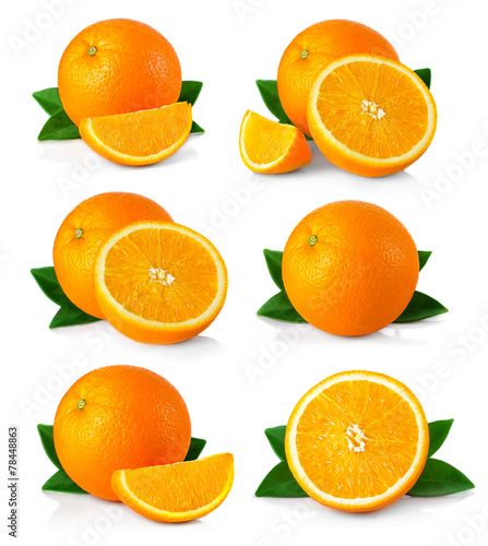 canvas print picture Set of ripe orange fruits with leaves and slices isolated