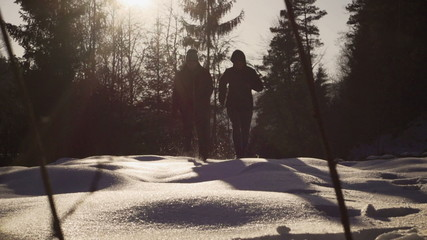 Couple running on the deep snow, steady, slow motion 240fps