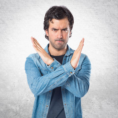 Man doing NO gesture over white background