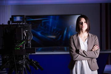 Recording at TV studio with television anchorwoman. TV NEWS