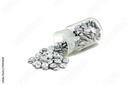 granulated zinc in a glass tube on a white background - 78450669