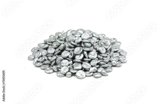 Leinwandbild Motiv a handful of granular zinc on a white background