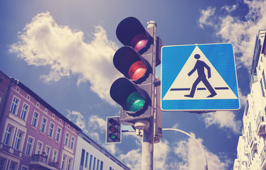 Retro filtered photo of traffic lights and pedestrian crossing s