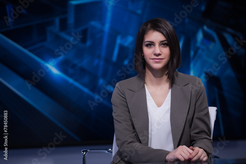 Beautiful television announcer at studio during live broadcast - 78450883