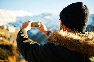 Happy man taking selfie self-portrait photo hiking. Hikers