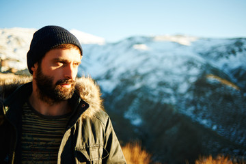 Hikers - people hiking. Bearded active man standing in sunset