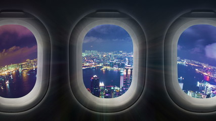 Timelapse video of city at night through airplane window