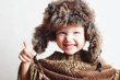 smiling child in fur Hat.Kids casual winter style.children