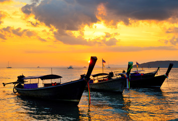 Traditional thai boats at sunset beach
