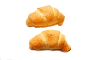 Two Fresh Baked Organic Croissant Rolls Over White
