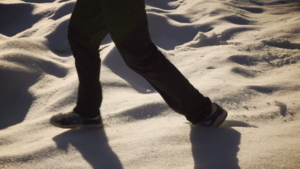 Man running down on the snow, steady, slow motion 240fps
