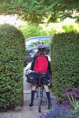 Young girl (12-13) going to school on bike