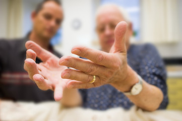 Germany, Patient taking hand massage from therapist