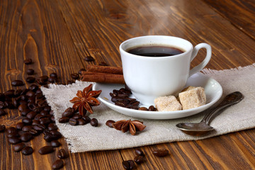 Cup of coffee with cane sugar and cinnamon