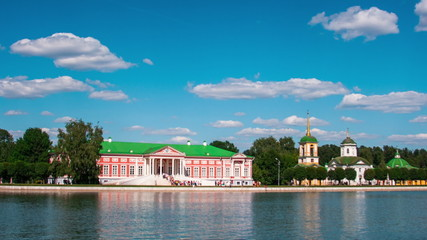 Kuskovo palace and pond with boats in the sunny summer day