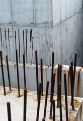 Grey concrete blocks with reinforcing bars