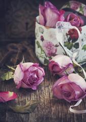 Violet roses on wood