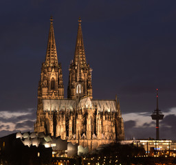 Germany, Cologne, Illuminated Cologne Cathedral against night sky