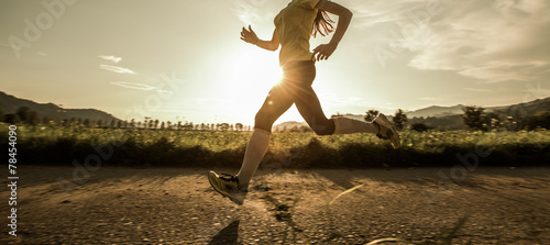 Leinwandbild Motiv Fit woman running fast