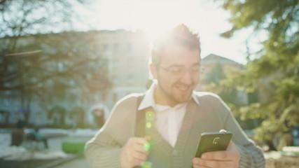 Business man on smartphone walking in street talking on mobile