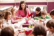 Leinwandbild Motiv Children in elementary school on the workshop with their teacher