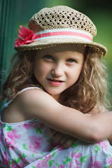 Little girl in summer dress and hat