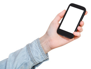 hand in shirt holds mobile phone isolated