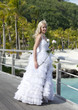 beautiful woman in dress of  bride on  bridge about sea edge