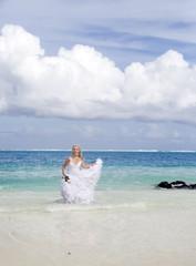 woman on edge of the sea on beach. Polynesia...