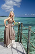 beautiful woman on a wooden platform over sea