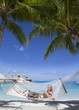 woman in  long sundress in  hammock on sea background..