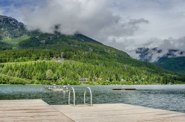 Wooden Jetty on a Mountain Lake and Cloudy Sky