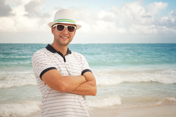 Man in white hat and sunglasses