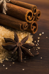 Cinnamon sticks with pure cane brown sugar on wood background