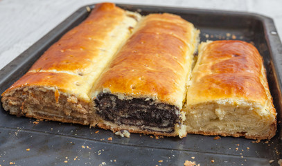 Roll with poppy seeds, walnut and cheese