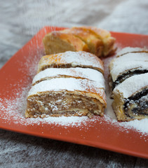 Roll cake with poppy seeds, walnut and cheese
