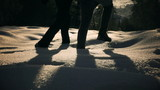 Couple walking together on deep snow, steady, slow motion