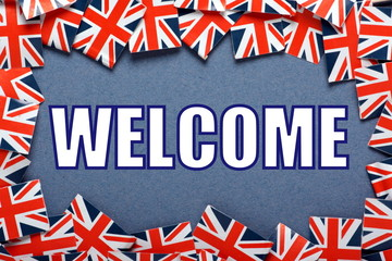 The word Welcome with a border of Union Jacks