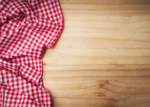 Tuinposter Boord tablecloth over wooden table with copy space