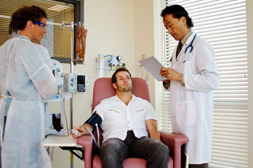 Doctor checking on patient status