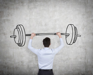 businessman holding barbell