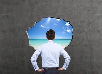 man looking to ocean