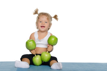 Smiling girl with weights of green apples